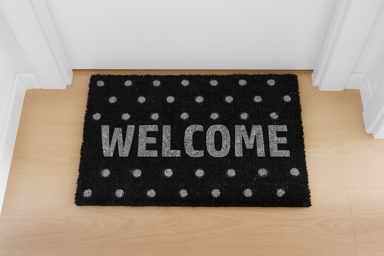 Welcome home doormat with close door
